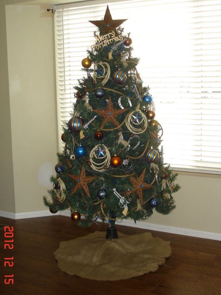 Western cowboy themed Christmas Tree Love the copper and blue - western christmas decorations