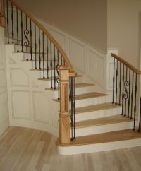 Curved Oak Staircase with Wrought Iron Railings
