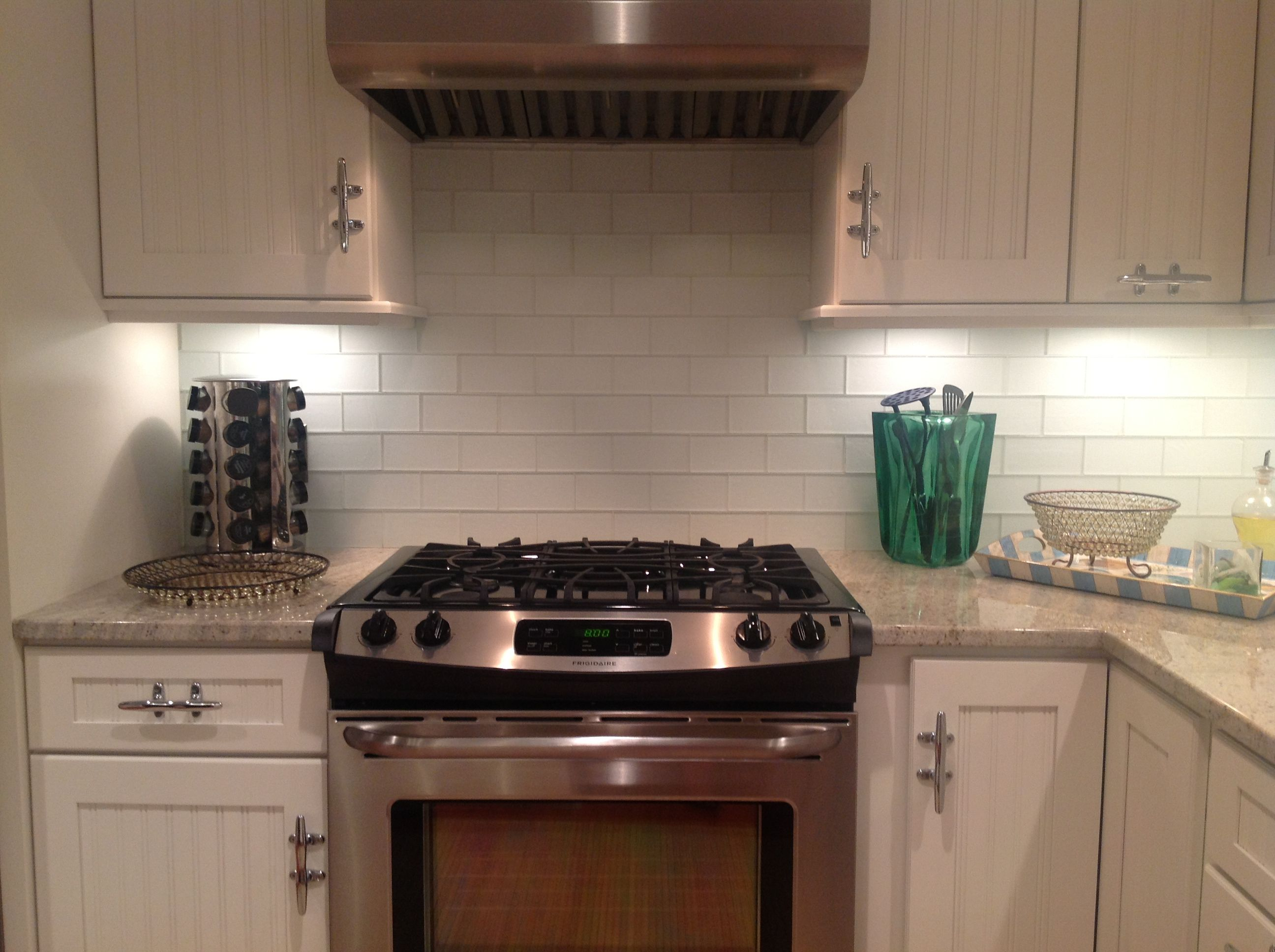 frosted glass tile kitchen kitchen glass backsplash Better Good contrast with the grey granite and white cabinets Frosted White Glass Subway