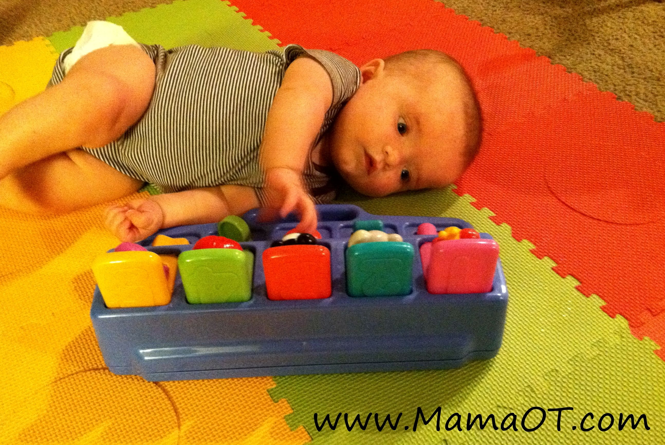Newborn Toys Babycenter Help Baby Learn To Roll Over