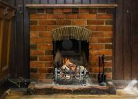 13049567-old-brick-fireplace-burning-logs.jpg 1,200867 ...