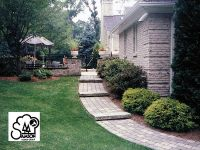 paver walkway on a slope. nice landscaping ideas too ...