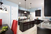 Gehan Homes Kitchen - Light Blue Walls, Red Accents, Dark ...
