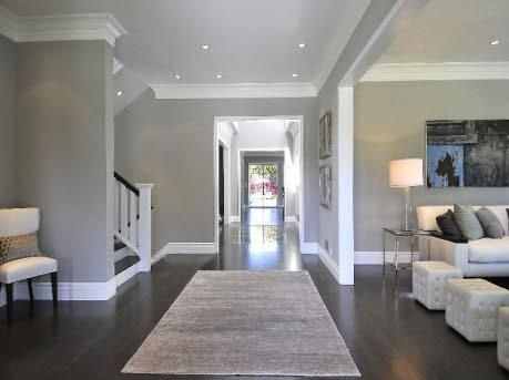 Dark Hardwood Floors, Grey Walls, White Molding\/Baseboards by - gray living room walls