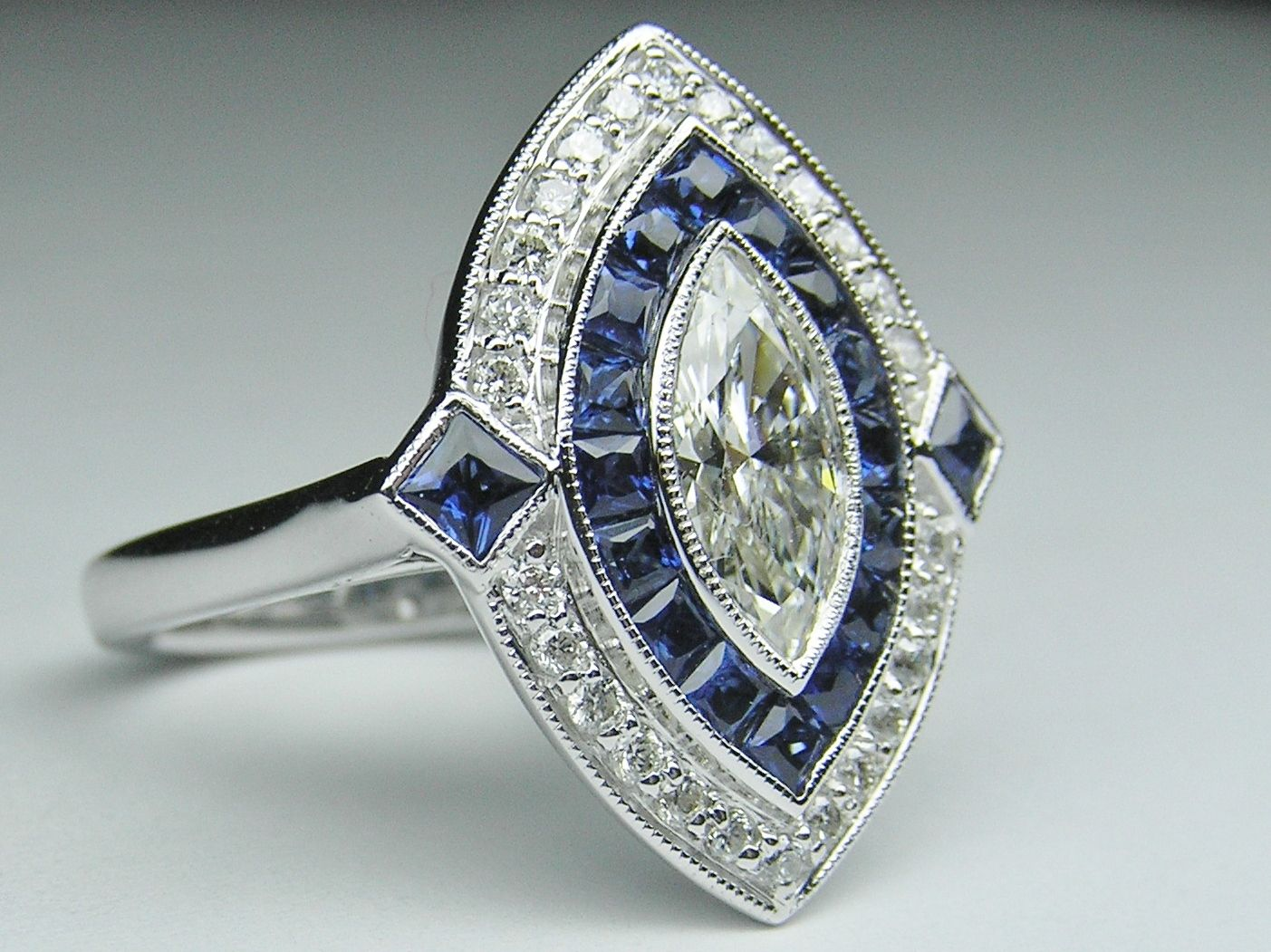 art deco wedding band Marquise Diamond Art Deco Engagement ring with Blue Sapphire Diamond Halo in 14K White gold