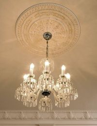 ceiling decor with crown molding, ceiling medallion and