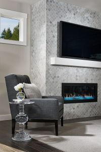 Floor-to-ceiling tile fireplace surround in our Lincoln ...