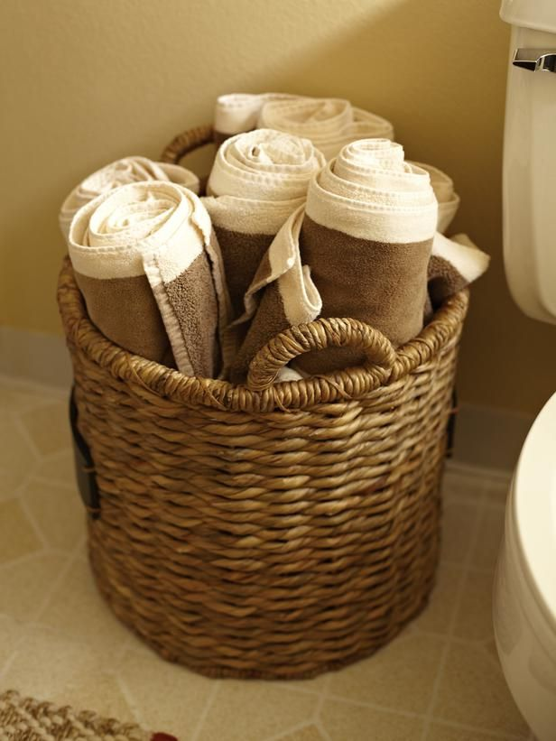 Tiny bathroom? Use a woven basket to store towels Cute display - decorative towels for bathroom ideas