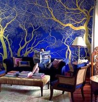 Shiny Gold Painted Tree On Royal Blue Wall | Creative ...