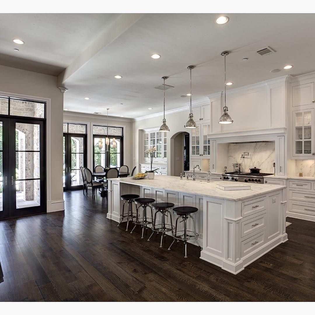 kitchen wood floors Love the contrast of white and dark wood floors By Simmons Estate Homes