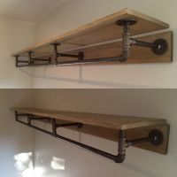 Pipe shelving. Made from metal piping and stained wood ...
