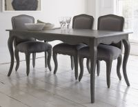 Elegant dining table with curved legs and attractive ...