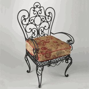 An Ornate Wrought Iron Chair Like This One Spray Painted A