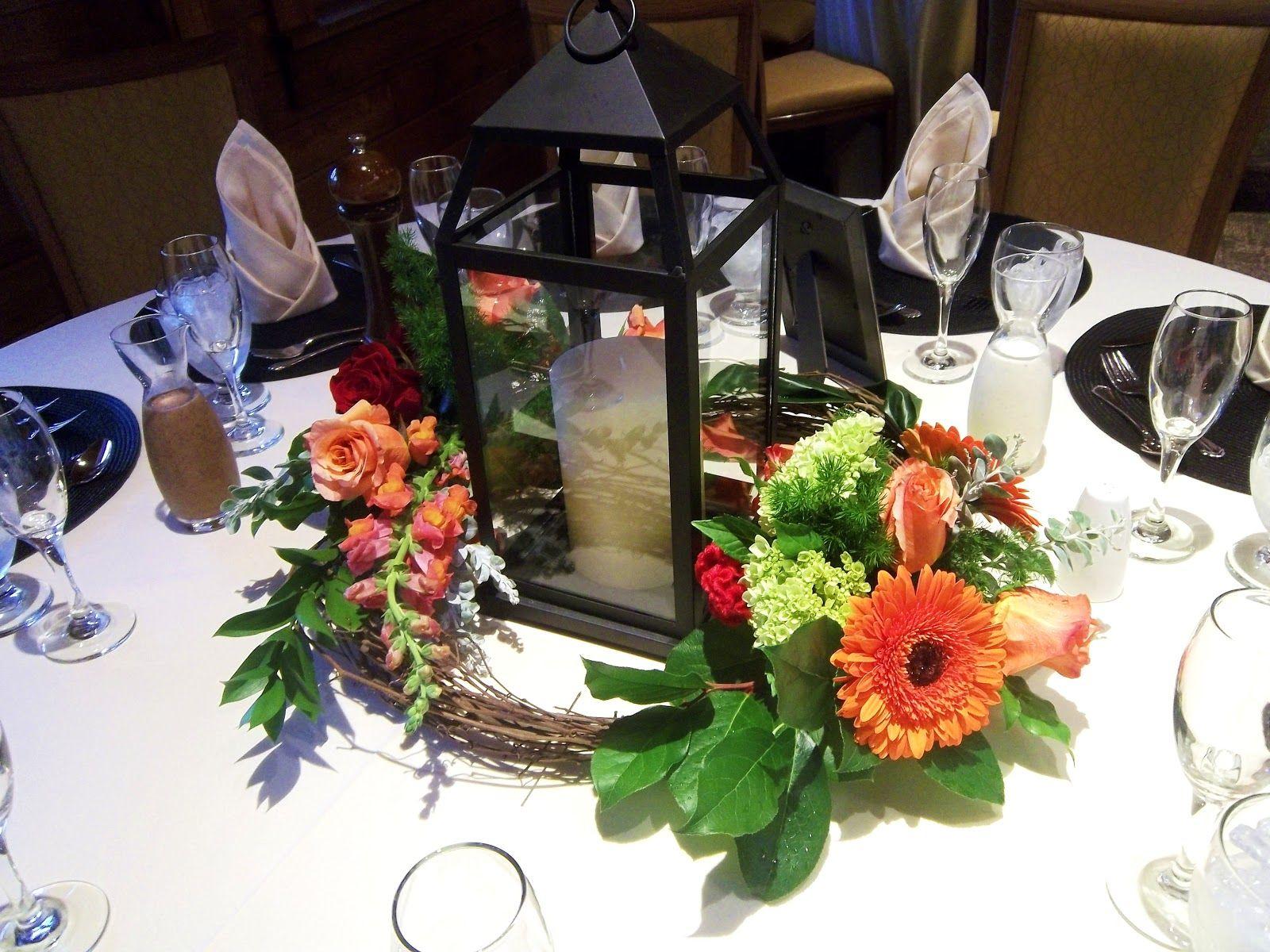 lanterns for weddings wedding lantern centerpieces fresh flowers in oasis or vials attached to vine wreath