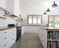 polished concrete flooring, white cabinets, wood ...