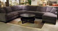I'm loving this big grey sectional... with dark wood, plum ...