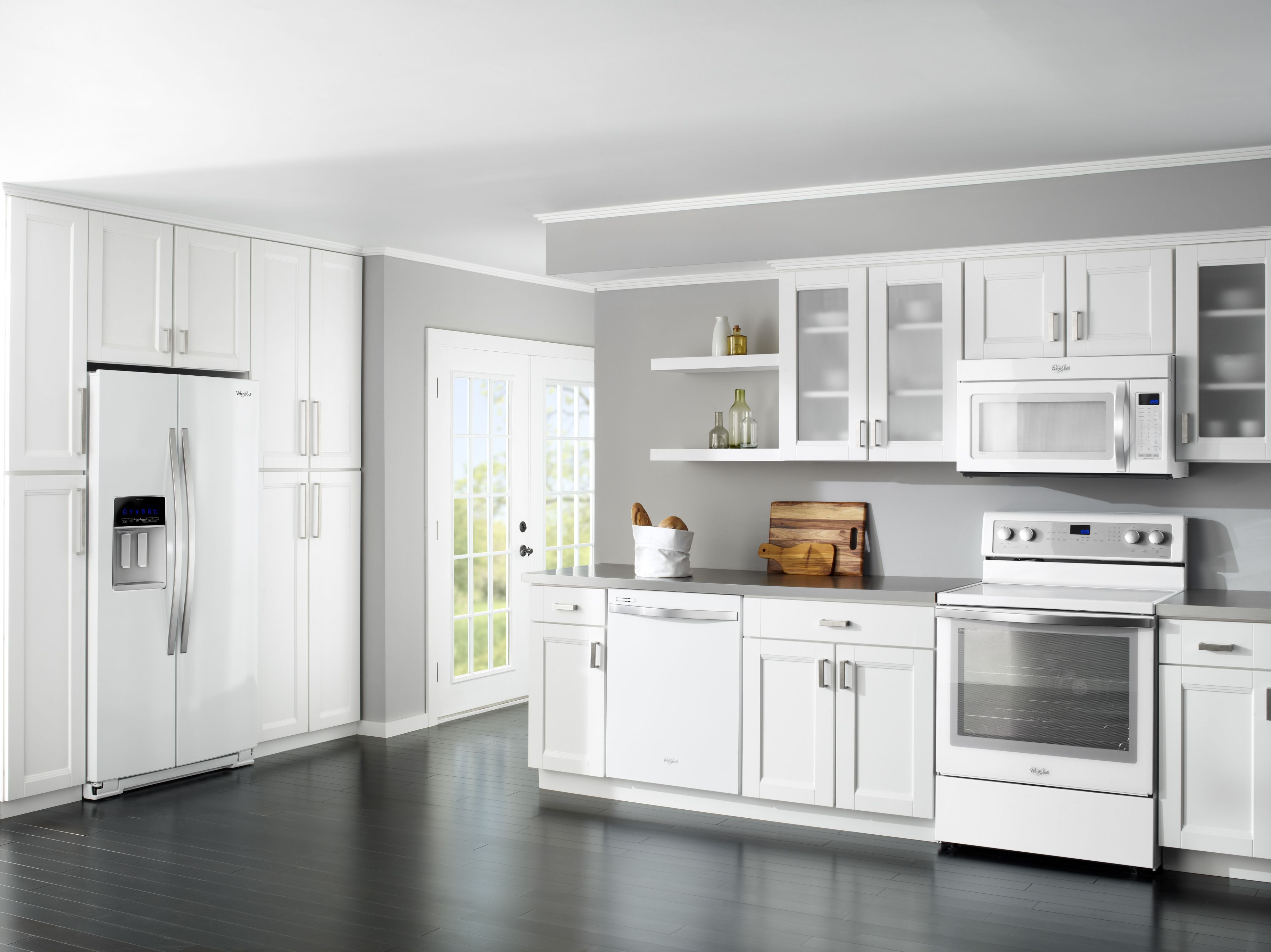 White with cool white appliances we love the all white kitchen trend this is a photo of whirlpool s white ice collection with white kitchen cabinetry