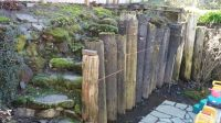 Before Photo:Retaining wall built from old telephone poles ...
