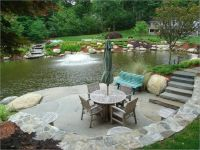 Blustone slab pond patio with waterfall and landscaping by ...