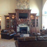 TV above fireplace, built in entertainment center, vaulted ...