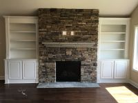 Stacked Stone Fireplace with a Flagstone Mantle and custom