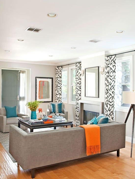 Modern gray sofa with turquoise and orange accents A fun way to - grey and turquoise living room