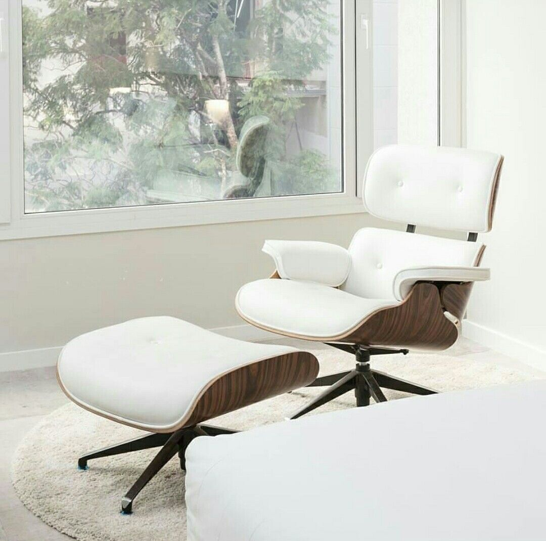 A Classic Eames Lounge Chair Replica With Palisander Wood
