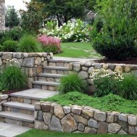 Natural stone retaining walls and steps to fight erosion