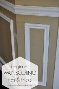 Installing trim wainscoting, such as a chair rail or ...