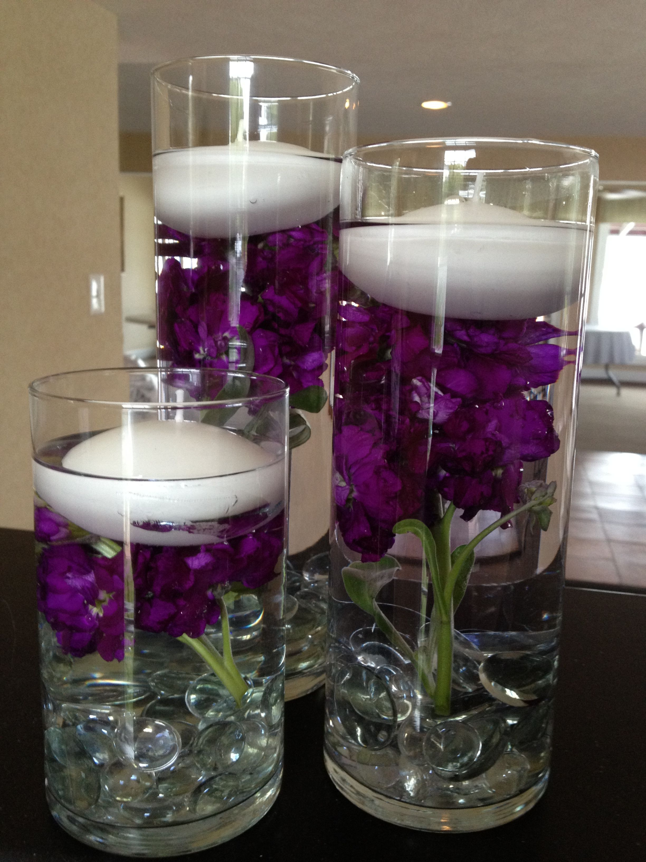 Candles With Gifts Inside Floating Candles W Dark Purple Stock Flowers Inside The