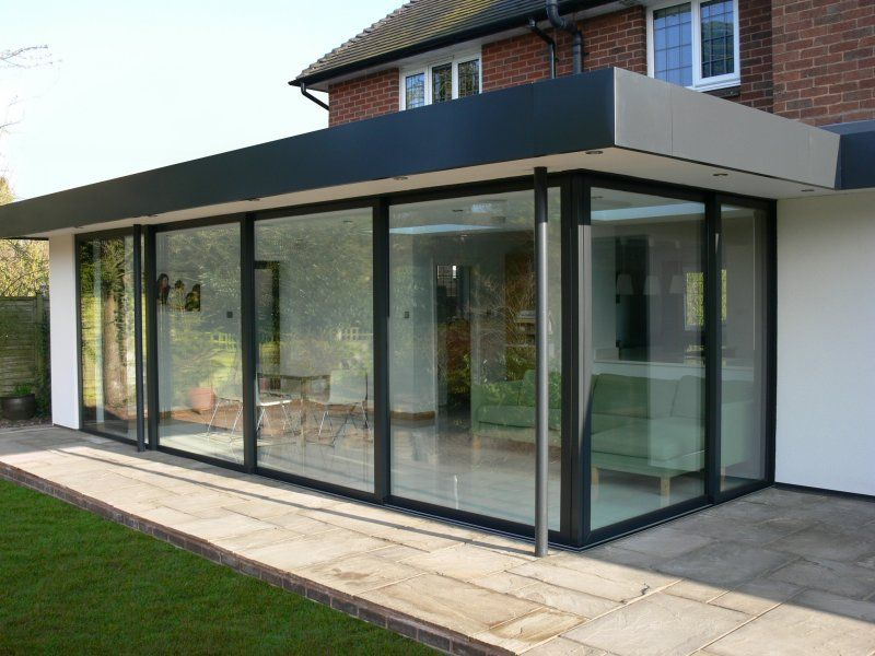 Glass patio enclosure flat roof house patio