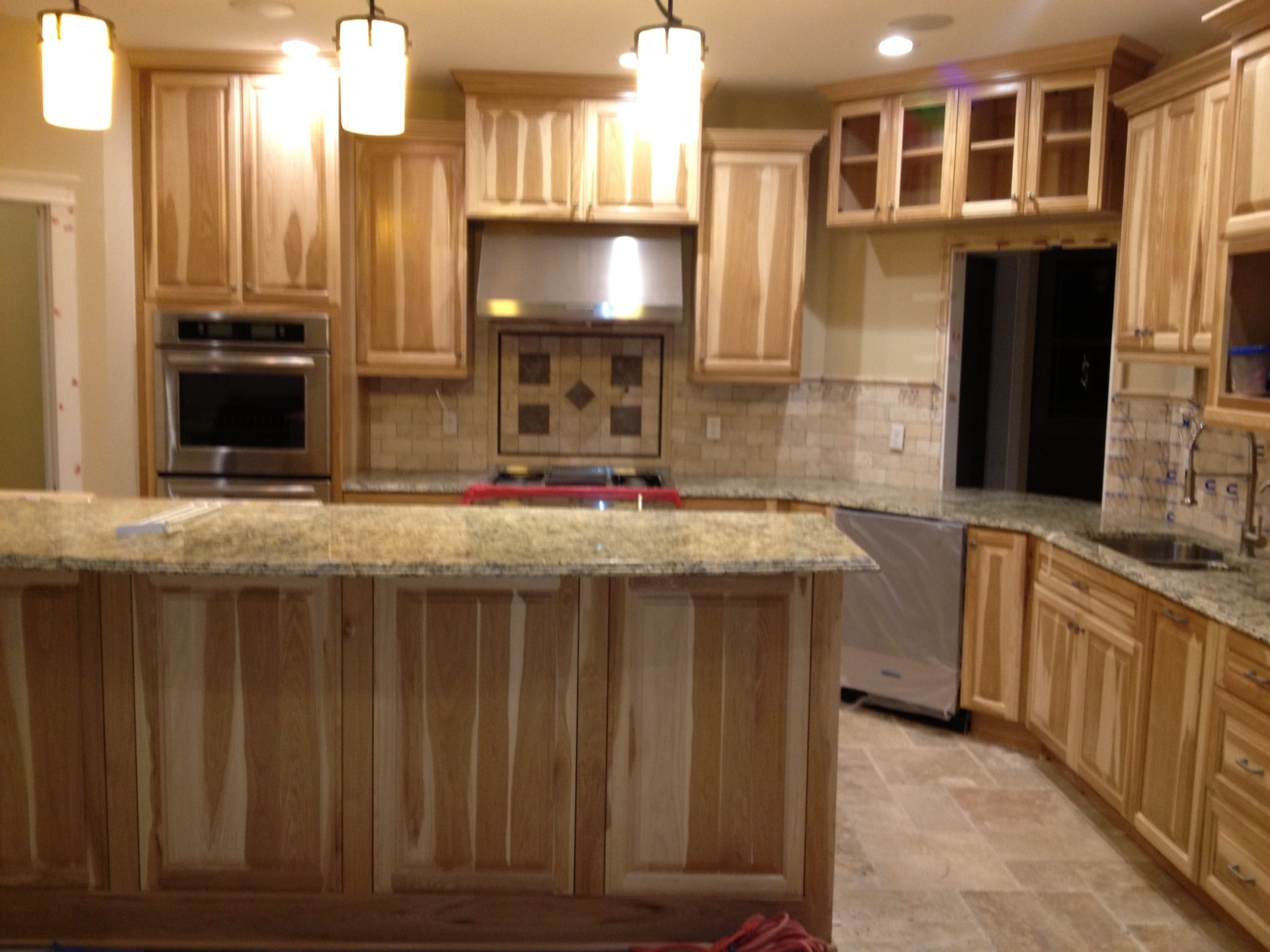 kitchen ideas kitchen cabinet countertop Kitchen with Hickory cabinets and travertine backsplash With granite countertops