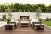 vertical white fence. outdoor fireplace in the wall. clean
