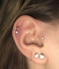 Double helix, lobe and tragus piercings :D