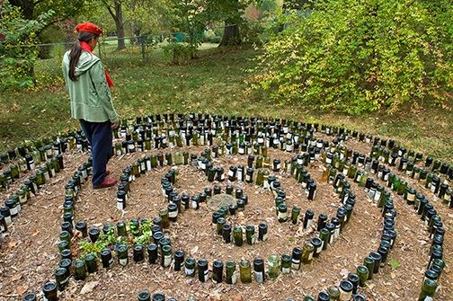 Labyrinth made of glass bottles inverted and placed into the - labyrinth garden design