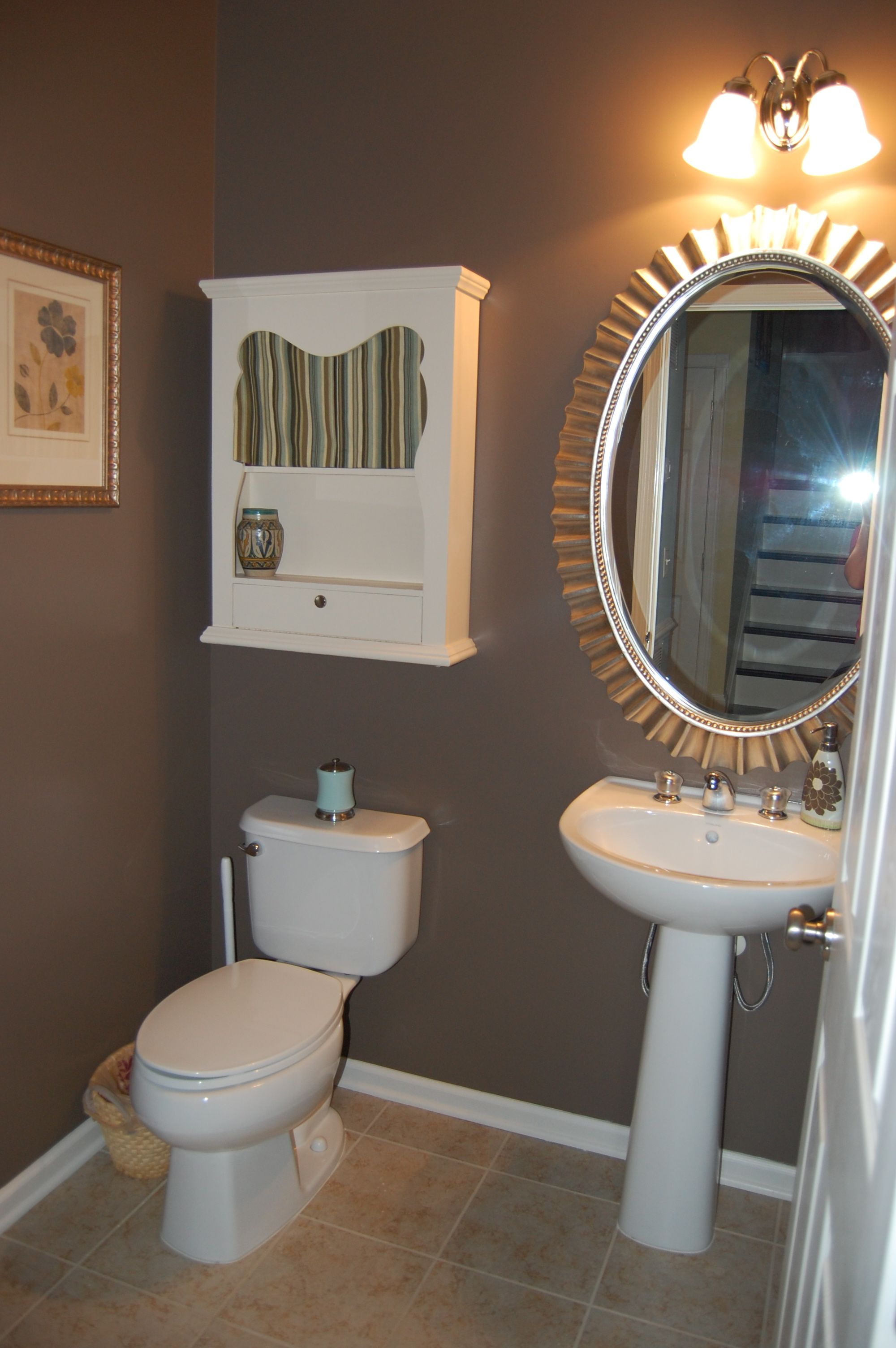 Bathroom lovable brown bathroom with outstanding oval wall mirror framed design also fetching white wood cabinet idea stunning bathroom paint ideas with