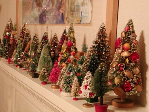 In need a mini christmas tree forest for the mantel! DECK THE - mini christmas tree decorations