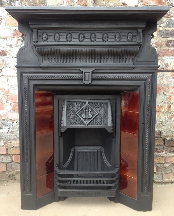 An original Edwardian antique cast iron fireplace with