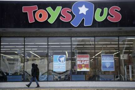 FILE - In this Jan. 24, 2018, file photo, a person walks near the entrance to a Toys R Us store, in Wayne, N.J. An investment firm projects more retail store closures are likely as consumers shift to online shopping. Photo: Julio Cortez, Associated Press