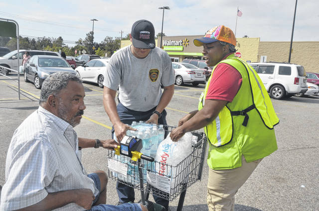 Red Cross feeds hungry, Walmart provides water, ice Robesonian