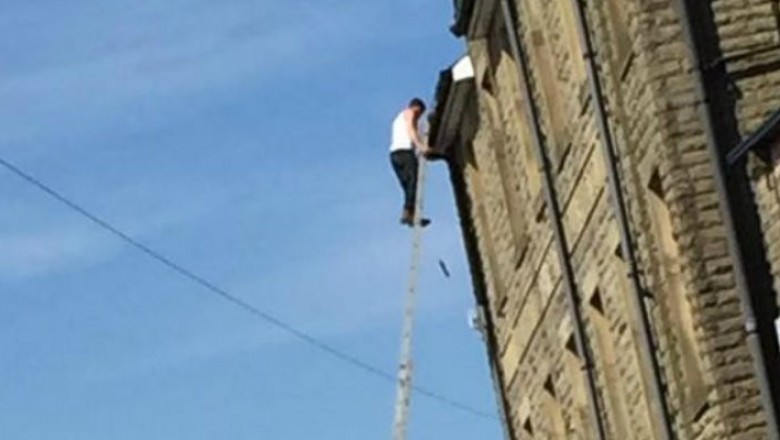 2019 Vertigo Resistant Handyman Snapped Atop 30ft Ladder
