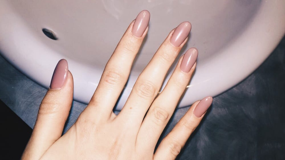 Long Almond Shaped Acrylic Nails With A Neutral Gel Polish