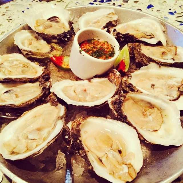 Caracol - Houston, TX, United States. Gulf oysters with salsa bruja and lime
