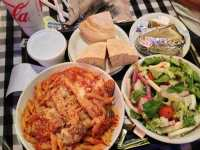 Penne arrabbiata, garbage salad, baked potato, extra bread ...
