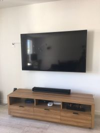 70 inch TV wall mounted by us! This tv was installed in an ...