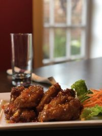 The Patio's crispy wing with Thai sweet chili sauce. - Yelp