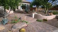 Front yard paver entry with pony wall surrounded by desert ...