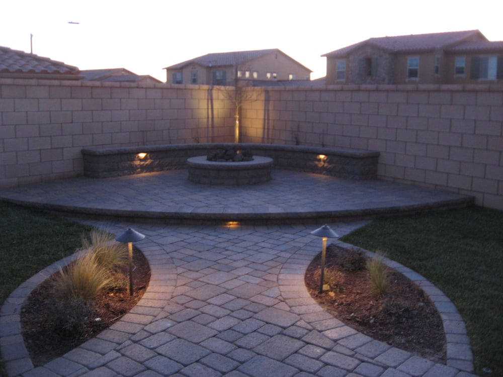elevated fire pit area with seating wall using belgards