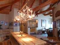 Beautiful dining area has hickory flooring, vaulted beam ...