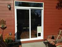 Complete vinyl sliding patio door with electronic pet door ...